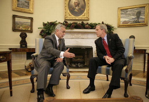 President George W. Bush meets with Vice President Tariq al-Hashemi of Iraq in the Oval Office Tuesday, Dec. 12, 2006. The two men spent their time together talking about the conditions in Iraq and what the United States can do to help the country's government succeed. White House photo by Eric Draper