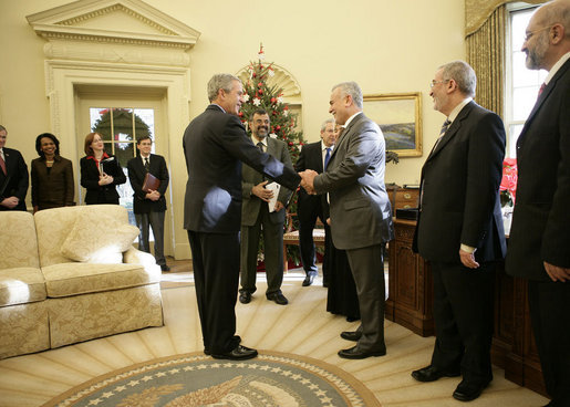 "President George W. Bush shakes the hand of Vice President Tariq al-Hashemi of Iraq as they near the end of their Oval Office visit Tuesday, Dec. 12, 2006. The President told Vice President Hashemi, ""Our objective is to help the Iraqi government deal with the extremists and killers, and support the vast majority of Iraqis who are reasonable people who want peace."" White House photo by Eric Draper"