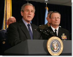 President George W. Bush answers questions from reporters following his meeting on Iraq with U.S military leaders at the Pentagon, Wednesday, Dec. 13, 2006. Admiral Edmund P. Giambastiani is seen at right.  White House photo by Eric Draper