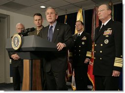 President George W. Bush listens to a reporter's question following his meeting on Iraq with U.S military leaders at the Pentagon, Wednesday, Dec. 13, 2006, joined by from left, Vice President Dick Cheney; Chairman of the Joint Chiefs of Staff, General Peter Pace and Vice Chairman of the Joint Chiefs of Staff Admiral Edmund P. Giambastiani, right. White House photo by Eric Draper