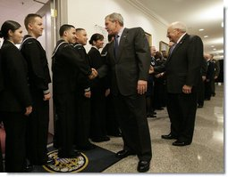 President George W. Bush and Vice President Dick Cheney shake hands with military personnel following their meeting with U.S military leaders at the Pentagon, Wednesday, Dec. 13, 2006. White House photo by Eric Draper