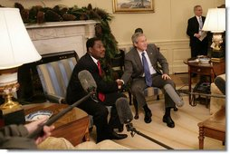 President George W. Bush welcomes President Boni Yayi of Benin to the White House Thursday, Dec. 14, 2006. Among other issues, the two leaders talked about joint efforts to combat HIV/AIDS and malaria in Benin. White House photo by Eric Draper
