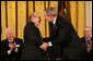 "President George W. Bush congratulates Natan Sharansky after honoring him with the 2006 Presidential Medal of Freedom during ceremonies Friday, Dec. 15, 2006, at the White House. Said the President, ""Americans first came to know Natan Sharansky as a voice for freedom inside an empire of tyranny. As a free man, he's become a political leader in Israel. He remains, above all, an eloquent champion for liberty and democracy. We honor Natan Sharansky for his life of courage and conviction."" White House photo by Eric Draper"