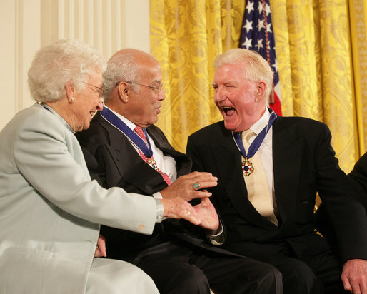"Author Paul Johnson is congratulated by Dr. Norman C. Francis and Ruth Johnson Colvin after receiving his Presidential Medal of Freedom from President George W. Bush Friday, Dec. 15, 2006, during ceremonies in the East Room of the White House. In honoring Mr. Johnson, President Bush said, ""Our country honors Paul Johnson, and proudly calls him a friend."" White House photo by Shealah Craighead"