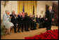 "Fellow recipients of the 2006 Presidential Medal of Freedom applaud as President George W. Bush bestows the honor on David McCullough during ceremonies Friday, Dec. 15, 2006, at the White House. Said the President, ""This chronicler of other times is one of the eminent Americans of our time. The nation owes a debt of gratitude to a fine author and a fine man."" White House photo by Shealah Craighead"
