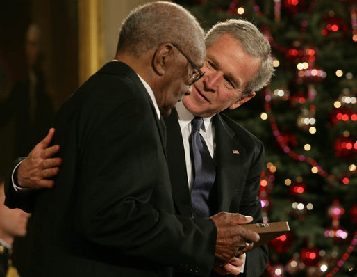 "President George W. Bush presents the 2006 Presidential Medal of Freedom to Warren O'Neil on behalf of his brother, baseball great Buck O'Neil, who passed away at the age of 94 in October. Said the President upon presentation of the honor, ""Buck O'Neil lived long enough to see the game of baseball, and America, change for the better. He's one of the people we can thank for that. Buck O'Neil was a legend, and he was a beautiful human being. And we honor the memory of Buck O'Neil."" White House photo by Shealah Craighead"