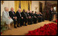"President George W. Bush looks back as he addresses the 2006 recipients of the Presidential Medal of Freedom on stage in the East Room of the White House Friday, Dec. 15, 2006. Said the President, ""The Presidential Medal of Freedom is our nation's highest civil honor. The medal recognizes high achievement in public service, science, the arts, education, athletics, and other fields. Today we honor 10 exceptional individuals who have gained great admiration and respect throughout our country."" White House photo by Shealah Craighead"