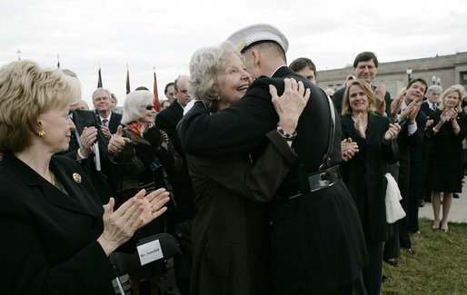 Joyce Rumsfeld, wife of Secretary of Defense Donald Rumsfeld, embraces General Peter Pace, Chairman of the Joint Chiefs of Staff, after she was presented with a medal in recognition of her service Friday, Dec. 15, 2006, during an Armed Forces Full Honor Review in honor of her husband. Mrs. Lynne Cheney looks on at left. White House photo by Eric Draper