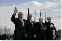 "Secretary of Defense Donald Rumsfeld acknowledges a standing ovation in his honor joined by President George W. Bush, Vice President Dick Cheney and General Peter Pace, Chairman of the Joint Chiefs of Statf, following Rumsfeld's farewell address Friday, Dec. 15, 2006, at the Armed Forces Full Honor Review at the Pentagon. The Secretary, who has served since 2001, told the audience that he will remember ""all those couragous folks that I have met deployed in the field; those in the military hospitals that we visited; and I will remember the fallen, and I will particularly remember their families from whom I have drawn inspiration.""  White House photo by Eric Draper"