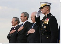 President George W. Bush, Vice President Dick Cheney and Joint Chiefs of Staff Chairman, General Peter Pace, stand with outgoing Secretary of Defense Donald Rumsfeld, left, during an Armed Forces Full Honor Review in the Secretary's honor at the Pentagon Friday, Dec. 15, 2006.  White House photo by Eric Draper