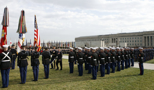 "Secretary of Defense Donald Rumsfeld reviews the troops Friday, Dec. 15, 2006, during an Armed Forces Full Honor Review in his honor at the Pentagon. The Secretary, who has served since 2001, told the audience that he will remember ""all those courageous folks that I have met deployed in the field; those in the military hospitals that we visited; and I will remember the fallen, and I will particularly remember their families from whom I have drawn inspiration."" White House photo by Paul Morse"