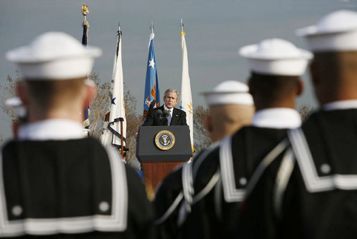 "President George W. Bush addresses the troops during an Armed Forces Full Honor Review at the Pentagon Friday, Dec. 15, 2006, in honor of outgoing Secretary of Defense Donald Rumsfeld, who served since 2001, telling the audience that Secretary Rumsfeld is ""one of America's most skilled, energetic and dedicated public servants."" White House photo by Paul Morse"