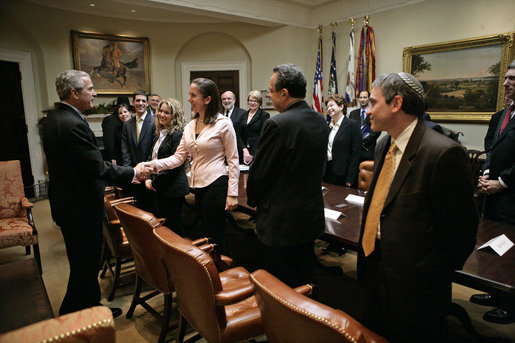 President George W. Bush greets Maya Pick, a student from the University of Virginia, during a meeting with Jewish leaders from the higher education community in the Roosevelt Room Monday, Dec. 18, 2006. White House photo by Eric Draper