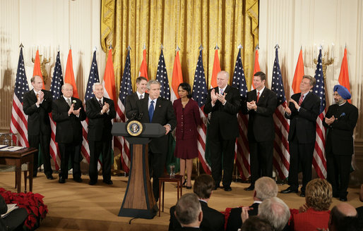 President George W. Bush is applauded as he addresses his remarks to invited guests prior to signing H.R. 5682 The United States-India Peaceful Atomic Cooperation Act, Monday, Dec. 18, 2006, in the East Room of the White House. Left to right are Rep. Thaddeus McCotter, R-Mich.; Rep.Gary Ackerman, D- NY; Sen. Richard Lugar, R-Ind.; Sen. Bill Frist, R-Tenn.; Secretary of State Condoleezza Rice; Rep. Joseph Crowley, D-NY; Sen. George Allen, R- Va.; Rep. Frank Pallone Jr., D-NJ; and Ambassador to the U.S. Raminder Jassal, Charge D'affaires of India. White House photo by Eric Draper