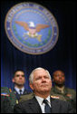 Robert Gates listens to President George W. Bush speak during his swearing-in ceremony as Secretary of Defense at the Pentagon Monday, Dec. 18, 2006. White House photo by Eric Draper