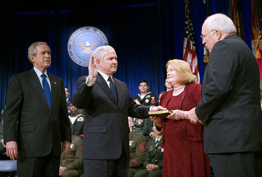 Vice President Dick Cheney swears in Robert Gates as Secretary of Defense at the Pentagon Monday, Dec. 18, 2006. Mr. Gate's wife Becky is pictured holding the Bible during the ceremony. White House photo by Eric Draper