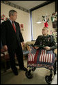 President George W. Bush shares a moment with U.S. Army Cpl. Shane Parsons after presenting him with a Purple Heart Friday, Dec. 22, 2006, at Walter Reed Army Medical Center where the Fostoria, Ohio, soldier is recovering from injuries received in Operation Iraqi Freedom. White House photo by Eric Draper