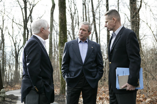 President George W. Bush discusses Iraq policy with Secretary of Defense Robert Gates, left, and Chairman of the Joint Chiefs of Staff General Peter Pace at Camp David, Saturday, Dec. 23, 2006. White House photo by Eric Draper