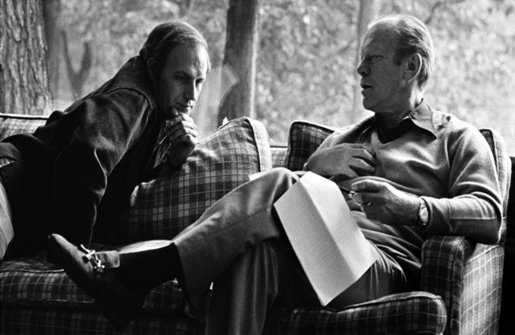 President Gerald R. Ford and Chief of Staff Dick Cheney meet at Camp David. Mr. Cheney served on the transition team and later as Deputy Assistant to the President when Ford assumed the Presidency in August 1974. In November 1975, Cheney was named Assistant to the President and White House Chief of Staff, a position he held throughout the remainder of the Ford Administration.