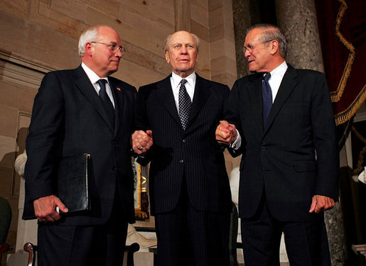 Former President Gerald R. Ford stands with his two White House Chiefs of Staff, Vice President Dick Cheney and former Defense Secretary Donald Rumsfeld, during a Gerald R. Ford Foundation awards dinner at the U.S. Capitol August 9, 2004. White House photo by David Bohrer