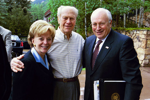 Former President Gerald R. Ford stands with Vice President Dick Cheney and Mrs. Lynne Cheney upon their arrival to Beaver Creek, Colorado for the American Enterprise Institute World Forum, June 20, 2003. President Ford, in partnership with British Prime Minister James Callaghan, French President Valery Giscard D'Estaing, and German Chancellor Helmut Schmidt, created the AEI World Forum to annually gather senior business executives, government officials, and world scholars for dialogue in international finance, trade, national security, social policy, and politics. White House photo by David Bohrer