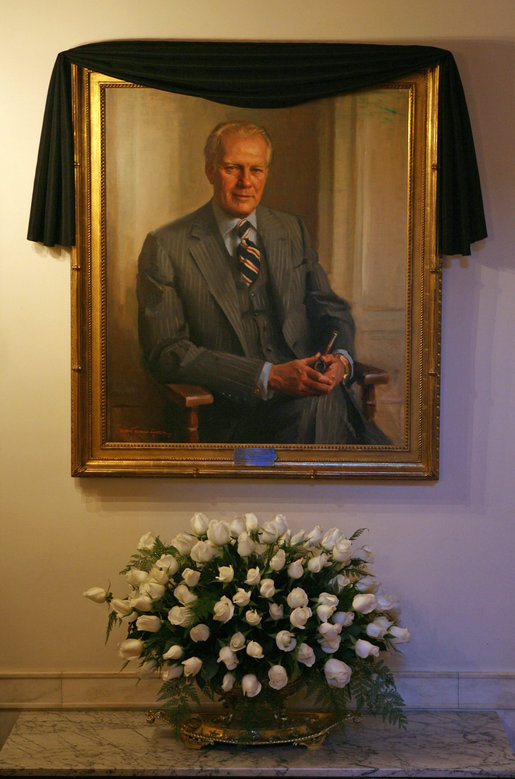 The portrait of former President Gerald R. Ford is draped with a black cloth in the Cross Hall of the White House Wednesday, Dec. 27, 2006. President Ford passed away Tuesday evening, Dec. 26. The portrait was painted by artist Everett Raymond Kinstler in 1977.