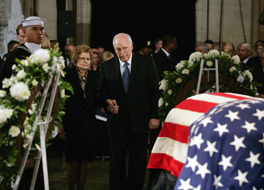 Vice President Dick Cheney holds the hand of former first lady Betty Ford as they stand before the casket of former President Gerald R. Ford during the State Funeral ceremony in the Capitol Rotunda on Capitol Hill, Saturday, December 30, 2006. White House photo by David Bohrer