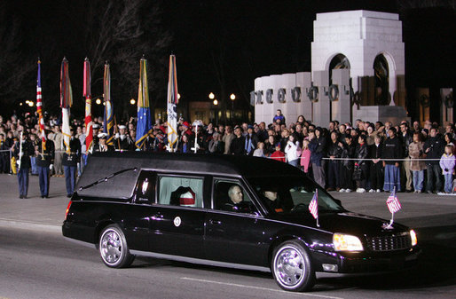 The hearse carrying the casket of former President Gerald R. Ford pauses at the World War II Memorial in Washington, D.C., Saturday evening, Dec. 30, 2006, in tribute to President Ford's service in the U.S. Navy during World War II, prior to the State Funeral ceremony at the U.S. Capitol. White House photo by Kimberlee Hewitt