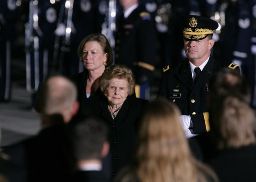 Former first lady Betty Ford and her daughter, Susan Ford Bales are escorted by Major General Guy Swan III upon the arrival of the casket of former President Gerald R. Ford to Andrews Air Force Base, Md., Saturday evening, Dec. 30, 2006, for the State Funeral ceremonies at the U.S. Capitol. White House photo by Shealah Craighead