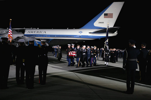 A military honor guard carries the casket of former President Gerald R. Ford upon arrival to Andrews Air Force Base in Maryland for the State Funeral ceremonies at the U.S. Capitol, Saturday, December 30, 2006. White House photo by David Bohrer