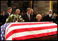 Former first lady Betty Ford kneels at the casket of her husband, former President Gerald R. Ford, in the U.S. Capitol rotunda during the State Funeral ceremony, Saturday, December 30, 2006. Accompanying Mrs. Ford are her children, from left, John G. Ford, Susan Ford Bales, Michael Ford and Steven Ford. White House photo by David Bohrer