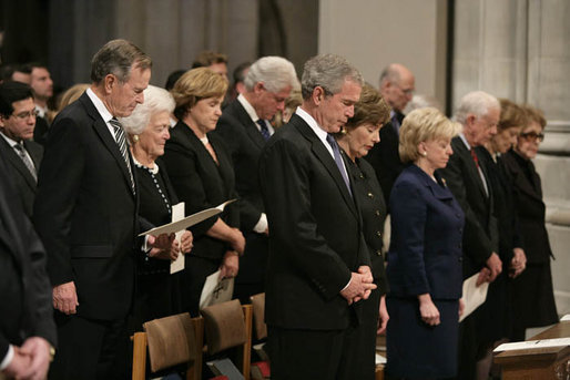 President George W. Bush and Laura Bush stand during the State Funeral for former President Gerald R. Ford at the National Cathedral in Washington, D.C., January 2, 2007. Standing back row left, former President George H.W. Bush, former first lady Barbara Bush, Dora Bush Koch, and former President Bill Clinton. Front row, left to right, Mrs. Lynne Cheney, former President Jimmy Carter, former first lady Rosalynn Carter, and former first lady Nancy Reagan White House photo by Eric Draper
