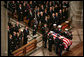 The casket of former President Gerald R. Ford is carried by military pallbearers to the front of the National Cathedral during his State Funeral in Washington, D.C., January 2, 2007. White House photo by Paul Morse
