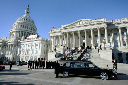A military honor guard descends the steps of the Senate carrying the casket of former President Gerald R. Ford from the Capitol to an awaiting hearse, Tuesday, January 2, 2007, for the procession to the State Funeral at the National Cathedral in Washington, D.C. White House photo by David Bohrer