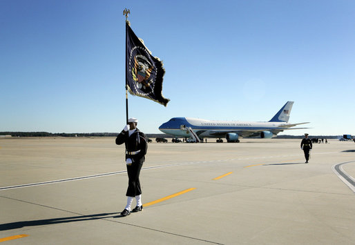 A Naval honor guard carries the Presidential Colors on the tarmac of Andrews Air Force Base, Md., as the plane carrying the body of former President Gerald R. Ford prepares to depart for Grand Rapids, Mich., Tuesday, January 2, 2007, following the former president's State Funeral in Washington, D.C. White House photo by David Bohrer