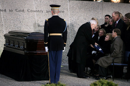 Vice President Dick Cheney presents the flag that draped the casket of former President Gerald R. Ford to former first lady Betty Ford during interment ceremonies at the Gerald R. Ford Presidential Museum in Grand Rapids, Mich., Wednesday, January 3, 2007. White House photo by David Bohrer