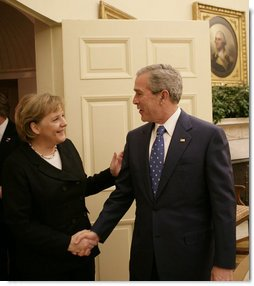President George W. Bush welcomes German Chancellor Angela Merkel to the Oval Office, Thursday, Jan. 4, 2006, at the White House.  White House photo by Eric Draper