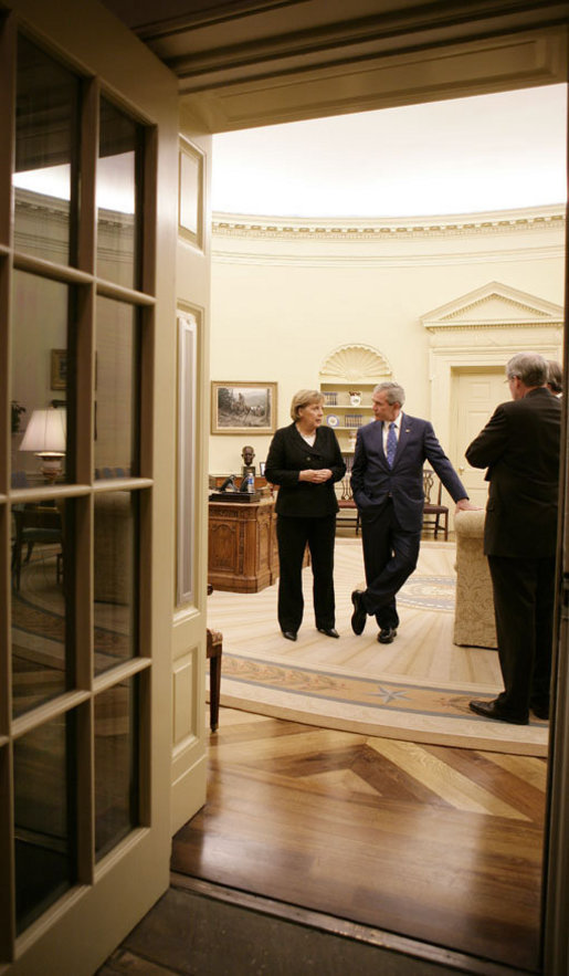 President George W. Bush and German Chancellor Angela Merkel meet in the Oval Office, Thursday, Jan. 4, 2006, prior to their joint news conference at the White House. White House photo by Eric Draper