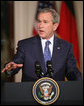 President George W. Bush gestures as he addresses his remarks during a joint news conference with German Chancellor Angela Merkel at the White House, Thursday, Jan. 4, 2006, discussing issues on security and peace in the Middle East, allied security efforts in Afghanistan and U.S.-European economic interest. White House photo by Paul Morse