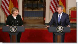 President George W. Bush and German Chancellor Angela Merkel react to a reporter's question during a joint news conference at the White House, Thursday, Jan. 4, 2006, where they answered questions on Iraq, the Middle East and U.S.-European economic issues. White House photo by Paul Morse
