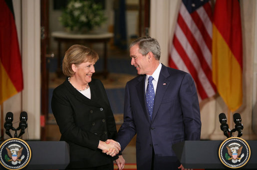 President George W. Bush and German Chancellor Angela Merkel shake hands at the conclusion of their joint news conference at the White House, Thursday, Jan. 4, 2006. White House photo by Paul Morse