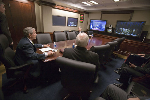 President George W. Bush participates in a secure video teleconference with Iraqi Prime Minister Nouri al-Maliki from the newly-renovated Situation Room at the White House Thursday, Jan. 4, 2007. Vice President Dick Cheney is pictured sitting next to the President. White House photo by Eric Draper