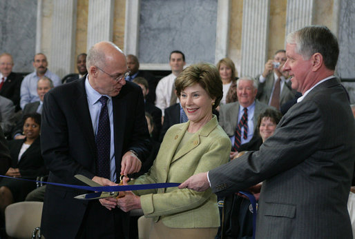 Mrs. Laura Bush is joined by U.S. Secretary of the Treasury Henry M. Paulson, Jr., left, and Richard C. Cote, curator, U.S. Department of the Treasury, as she cuts the ceremonial ribbon to mark the completion of the first major restoration at the U.S. Treasury Building, Thursday, Jan. 11, 2007, in Washington, D.C. White House photo by Shealah Craighead