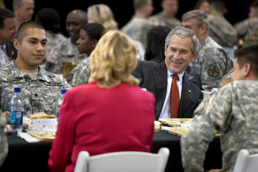 President George W. Bush talks with U.S. troops and their families over lunch during his visit to Fort Benning, Ga., Thursday, Jan. 11, 2007. White House photo by Eric Draper
