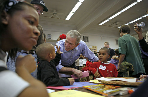 "President George W. Bush greets volunteers big and small during Martin Luther King, Jr. Day at Cardozo Senior High School in Washington, D.C., Monday, Jan. 15, 2007. ""One of the things that Mrs. King wanted was for MLK Day to be a day of service. It is not a day off, but it's a day on,"" said the President. ""And so I'm here at Cardozo High School to thank the hundreds of people who have showed up to serve the country by volunteering."" White House photo by Paul Morse"
