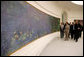 Mrs. Laura Bush tours the Musee de l'Orangerie with Director Pierre Georgel, right, and US Ambassador Craig Stapleton and his wife Mrs. Stapleton, left, in Paris Monday, Jan. 15, 2007. The Musee de l'Orangerie recently underwent renovations and is home to eight paintings from Monet's large-format series of Water Lilies. White House photo by Shealah Craighead