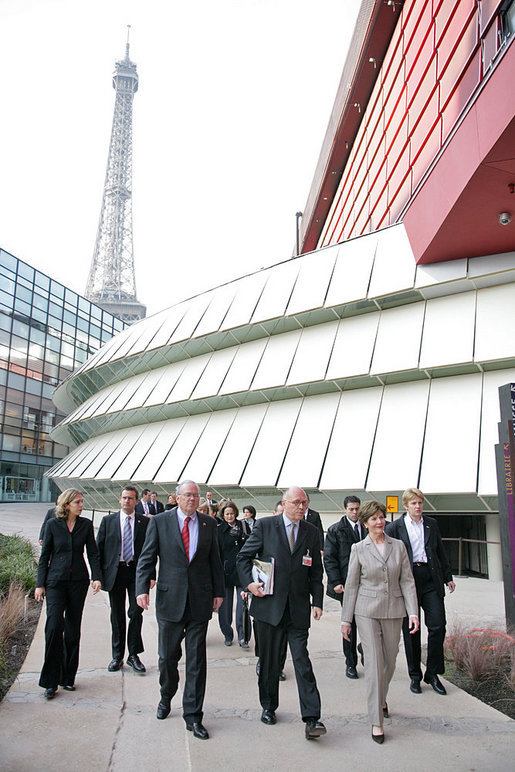 The Eiffel Tower stands tall in the background as Mrs. Laura Bush walks with Stephane Martin, President of the Musee du quai Branly, center, in Paris Monday, Jan. 15, 2007. Mrs. Bush toured the museum with US Ambassador Craig Stapleton, left, and his wife Mrs. Stapleton. White House photo by Shealah Craighead