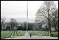 Within site of the Eiffel Tower, an American Flag hangs at half-staff during the official period of mourning for President Gerald R. Ford at the Suresnes American Cemetery near Paris Tuesday, Jan. 16, 2007. Dedicated in 1919 by President Woodrow Wilson, the cemetery was established for American troops who died in World War I. In 1952, a World War II section was added for the remains of 24 unknown soldiers. White House photo by Shealah Craighead