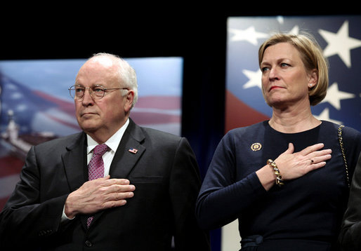 Vice President Dick Cheney stands with Susan Ford Bales, daughter of former President Gerald R. Ford, while the U.S. national anthem is played during the naming ceremony for the new U.S. Navy aircraft carrier, the USS Gerald R. Ford, at the Pentagon in Washington, D.C., Tuesday, Jan. 16, 2007. The nuclear-powered vessel will go into service in 7-8 years and will be the first in the new Gerald R. Ford class of aircraft carriers in the U.S. Navy. White House photo by Paul Morse