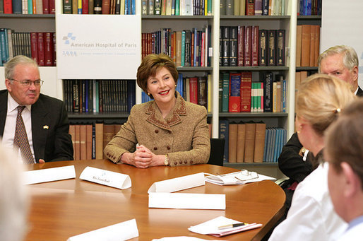 Mrs. Laura Bush and US Ambassador Craig Stapleton, left, participate in a roundtable discussion at the American Hospital of Paris Tuesday, Jan. 16, 2007, in Neuilly-on-Seine, France. White House photo by Shealah Craighead